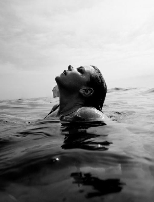 woman emerging from beneath water